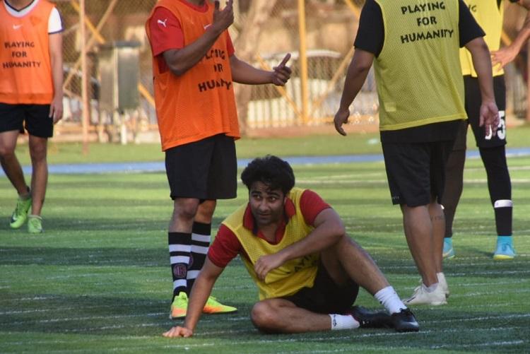 aadar jain spotted playing football with ranbir kapoor