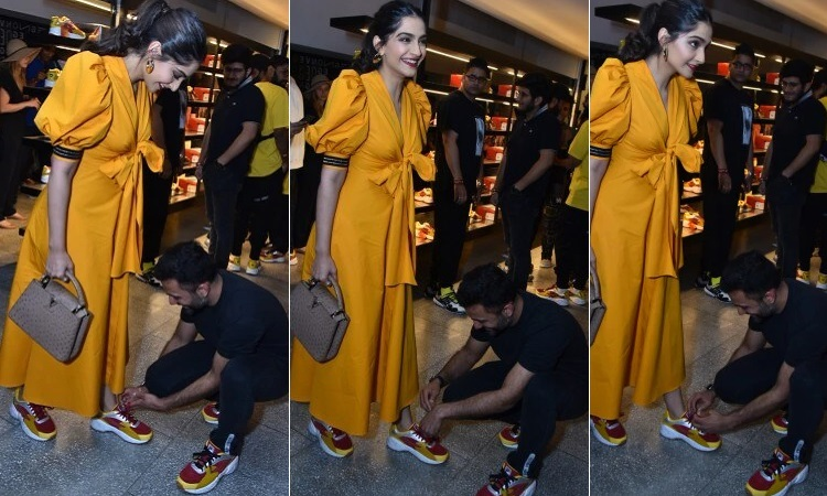 anand ahuja wins heart by tying wife sonam's shoe lace at a store launch