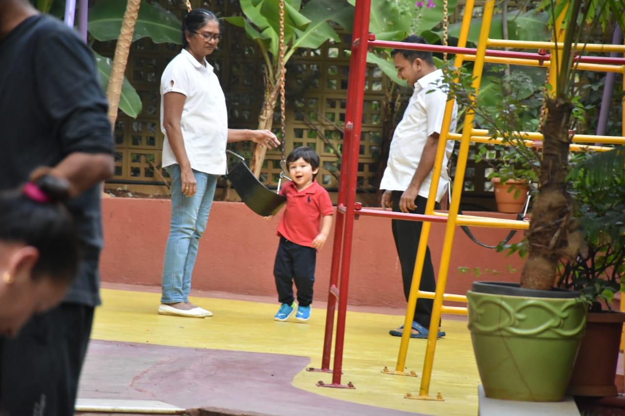 taimur enjoying in park pic