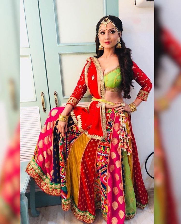 4c12dbff3d3e20 True to the gorgeous Gujrati trend of lehenga-cholis, Mouni Roy's outfit is  apt to dance away the night of music and devotion. Her silver jewellery  also is ...